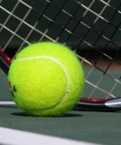 Tennis Ball with a Racket